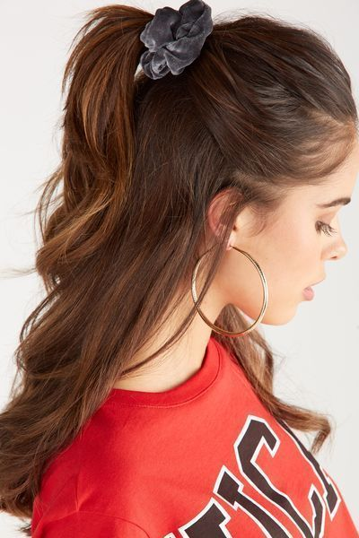 Long brown hair girl with high ponytail wearing a black scrunchie