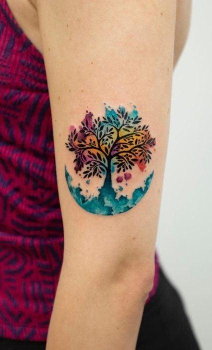 Tree tattoo with rainbow color shades