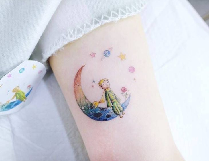 The little prince tattoo with shades of rainbow colors
