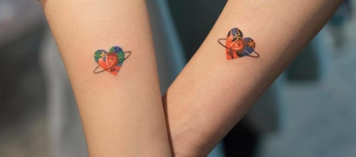 Tattoos to share with your best friend with heart design with an interior landscape