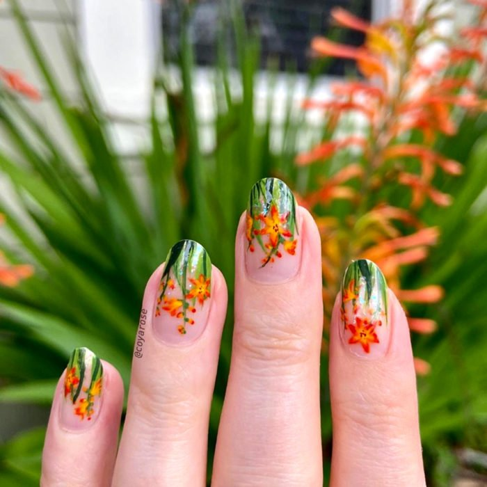 Flower manicure; crocosima nails, orange