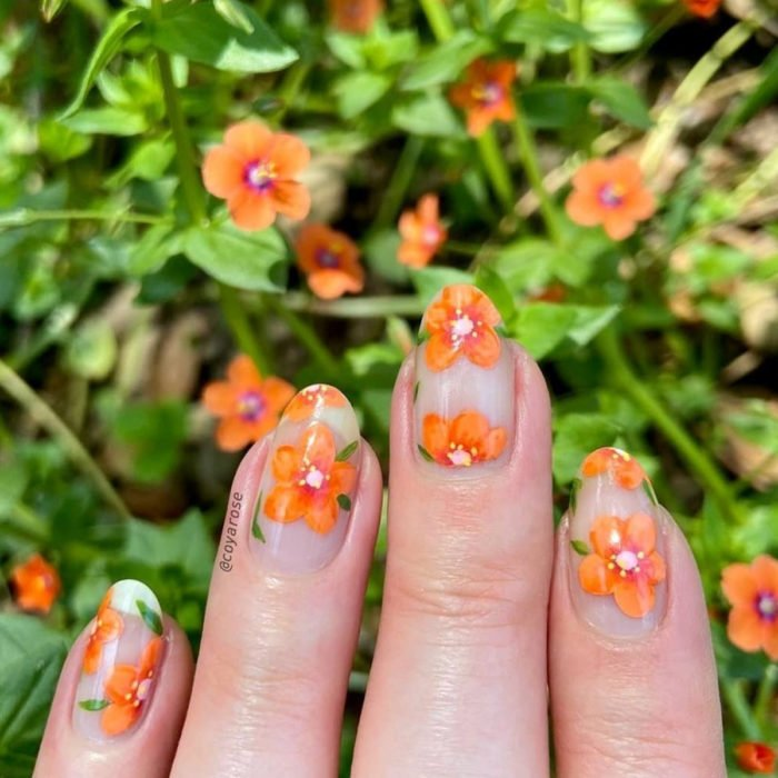 Flower manicure; orange scarlet pimpernel nails