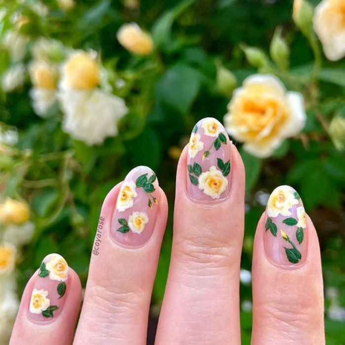 Flower manicure; nails with white and yellow roses design