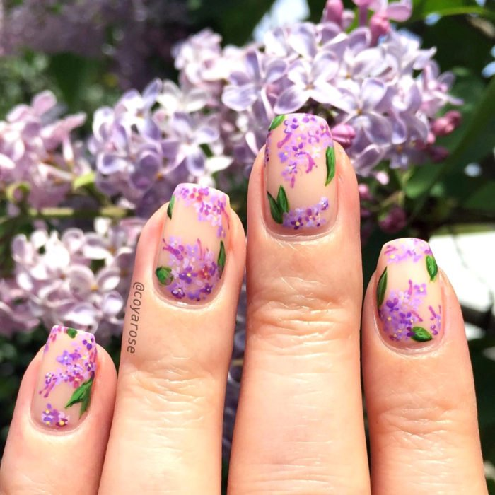 Flower manicure; purple lilac nails