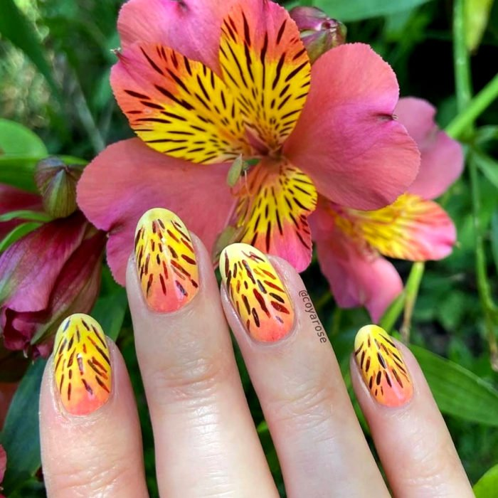 Flower manicure; pink and yellow field lily nails