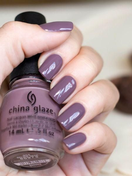woman hands with manicure in shades of violet gray