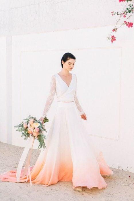 Bride in white dress and peach bottom