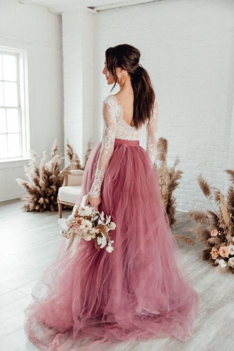 Bride with pink tulle dress at the bottom