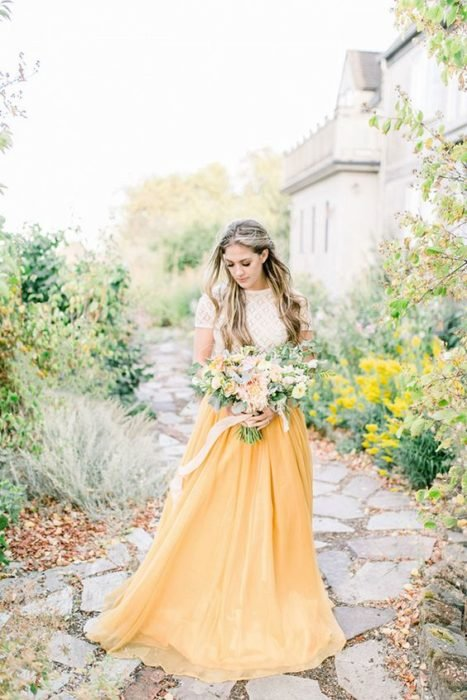 Bride with white dress on top and yellow on bottom