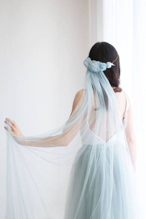 Bride from the back with blue headdress and veil