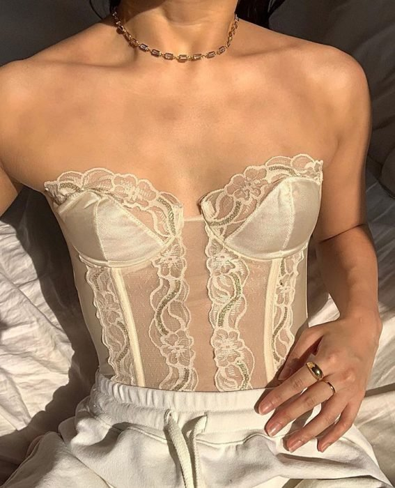 girl with white lace bustier and white waist pants