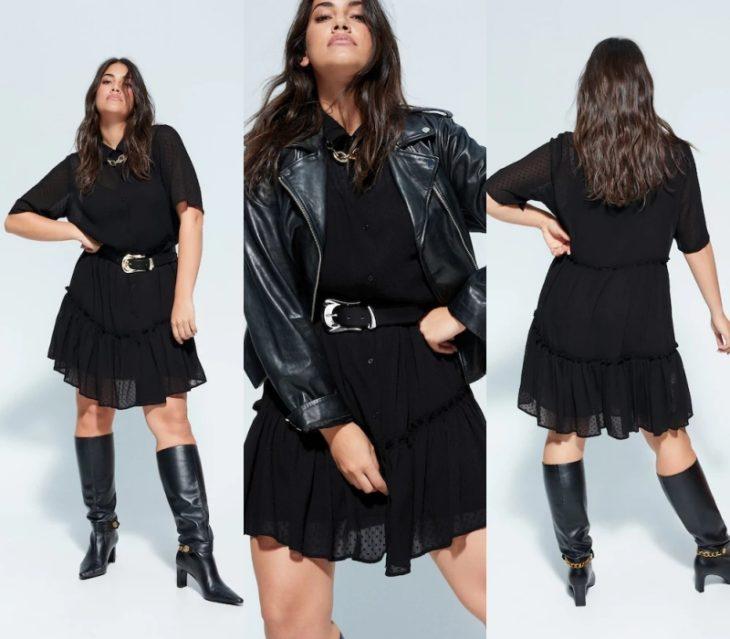 chica curvy de cabello castaño largo usando un vestido negro de gasa, una chaqueta de cuero negra y botas de piel a la rodilla, cinto de piel con hebilla de metal