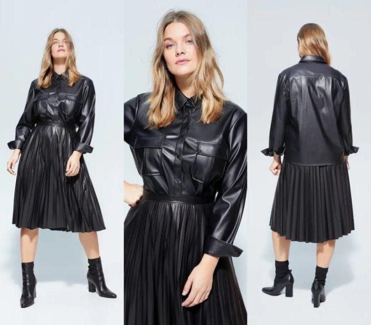 chica rubia con cabello largo usando una camisa de cuero color negro, falda de piel plisada larga y botas negras de cuero