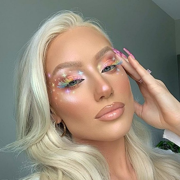 blonde girl with pastel color makeup and star designs