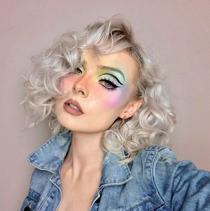 girl with platinum hair wearing makeup with pastel shadows
