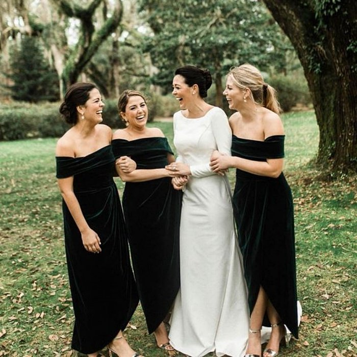 bridesmaids with the bride, wearing dark green velvet dresses