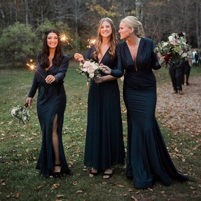 bridesmaids in long sleeve dresses in emerald green
