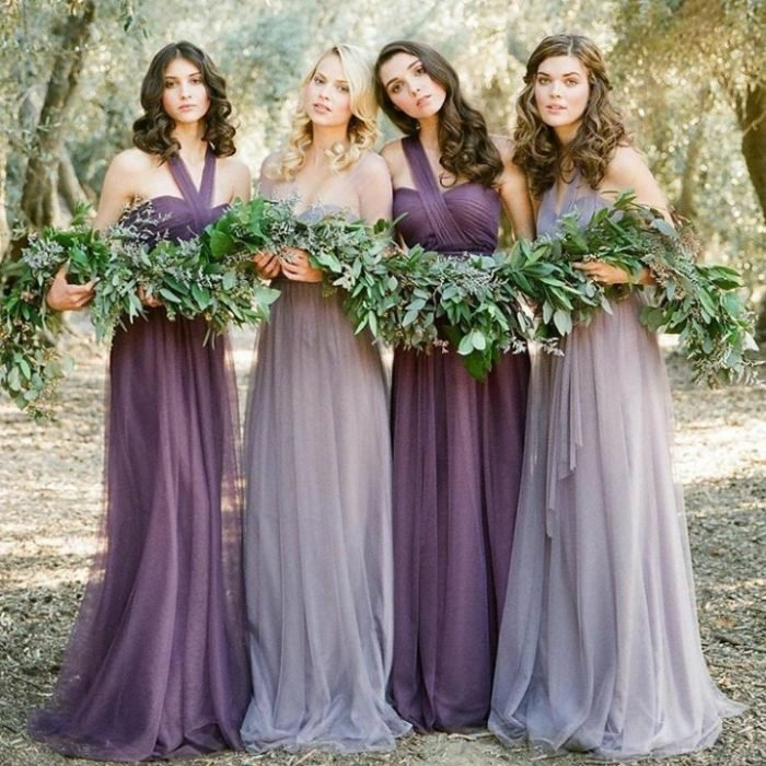 bridesmaids wearing long chiffon dresses in dark purple and lilac colors