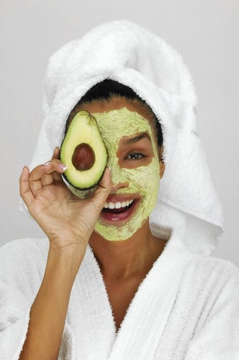 girl with avocado mask to hydrate the skin