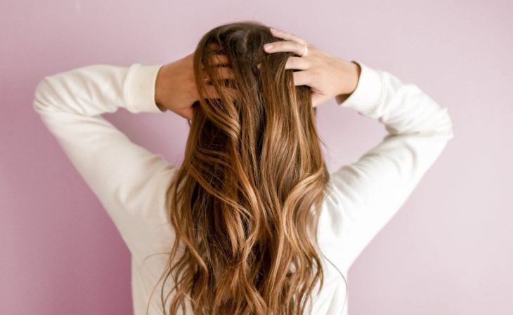 Girl from behind showing her long strong hair