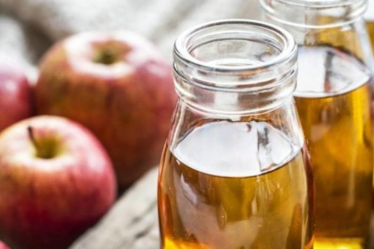 Glass bottles with apple cider vinegar inside