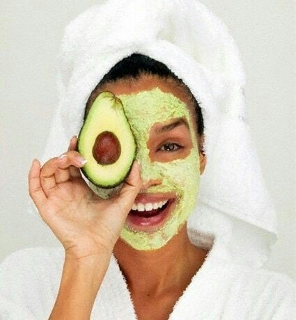 Girl wearing an avocado mask with gelatin