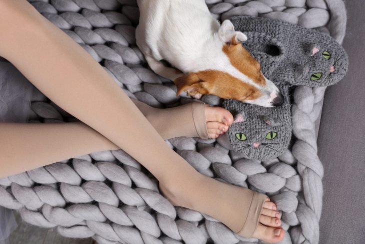 Woman wearing compression stockings