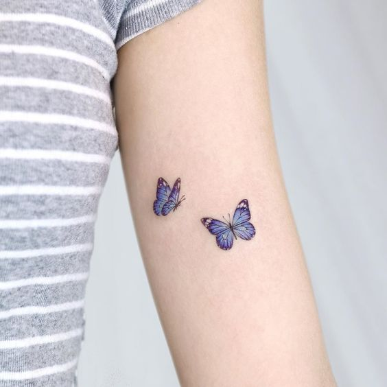 Tattoo with two miniature butterflies