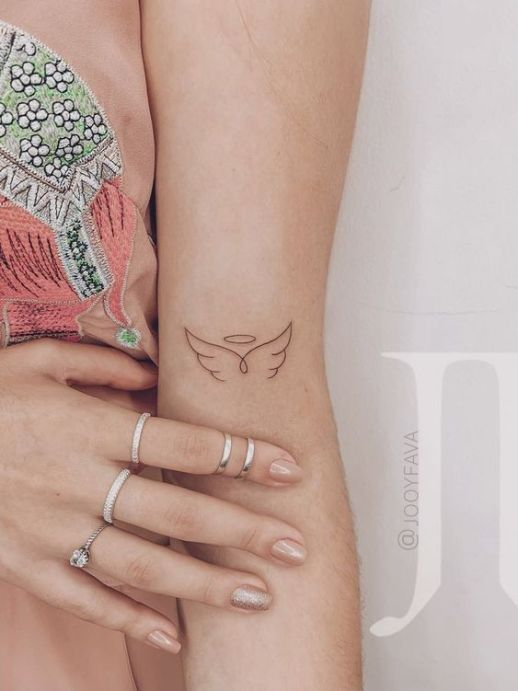 Tattoo of a silhouette of an angel