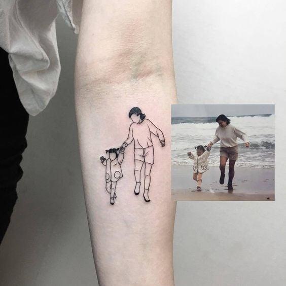 Tatuaje eplica de una fotografía infantil