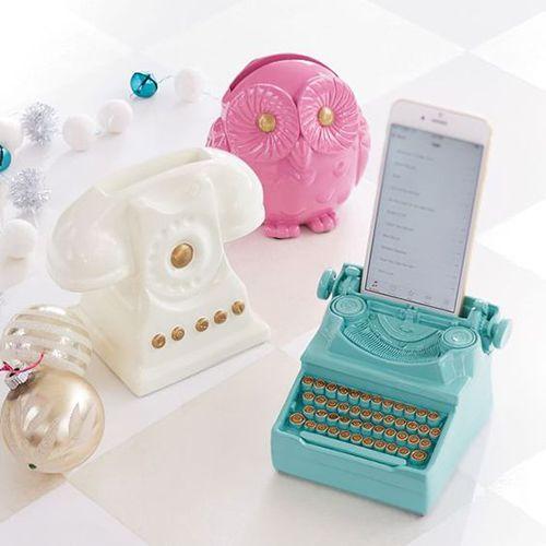 Soporte para celular en forma de maquina de escribir