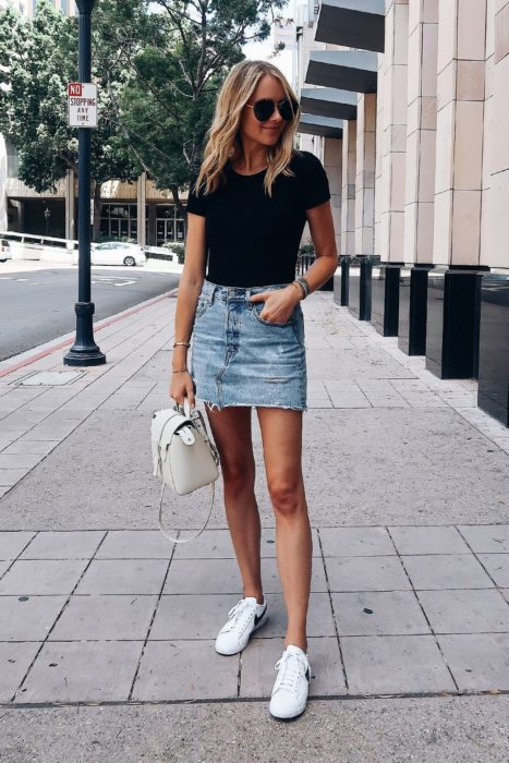 Girl wearing denim mini skirt and basic black blouse