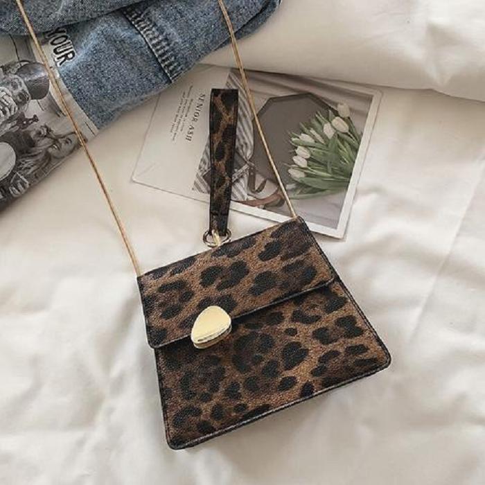 Small animal print handbag and gold colored chain strap