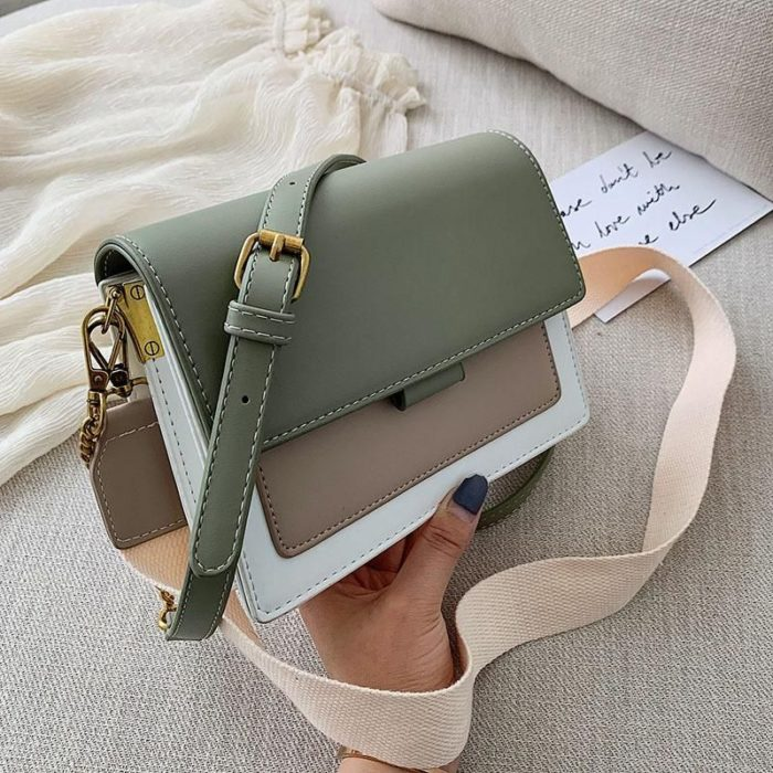 Small white handbag with camel details and green flap, along with cream strap