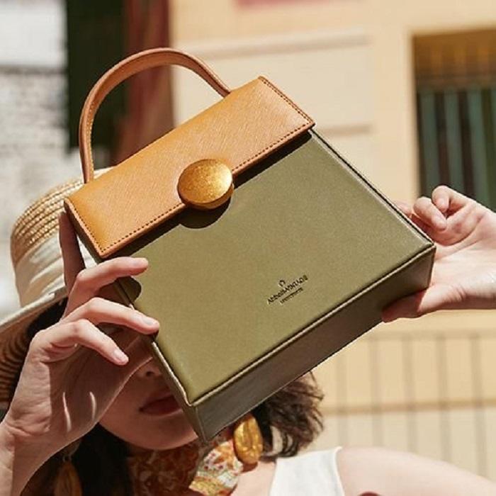 Small olive green handbag with mustard flap