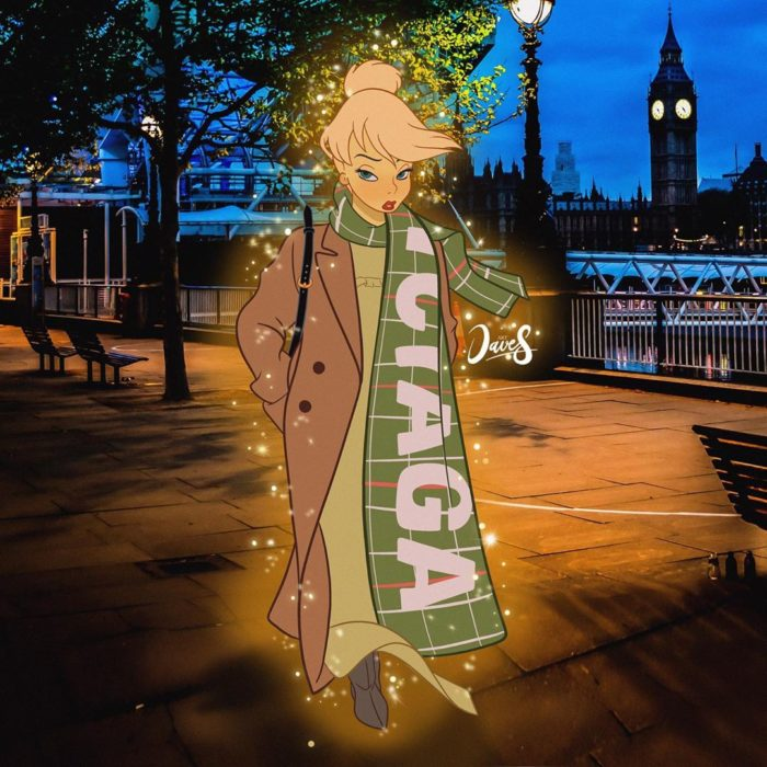 Campanita usando un vestido de noche verde y un abrigo color camel