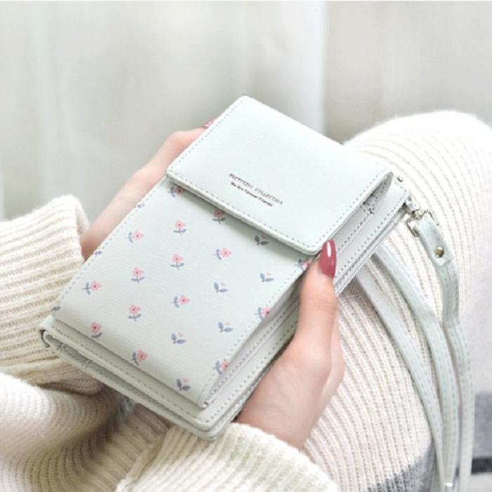 Cartera con aza de bolsa color aqua y detalles rosados