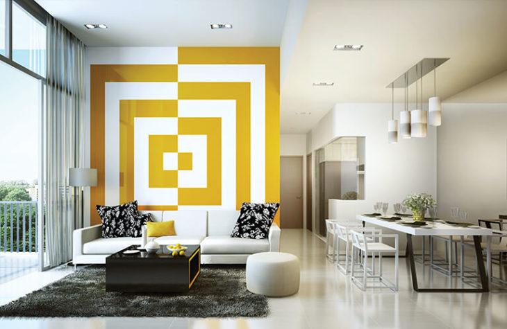 Sala de estar decorada con diferentes patrones y colores en amarillo con blanco