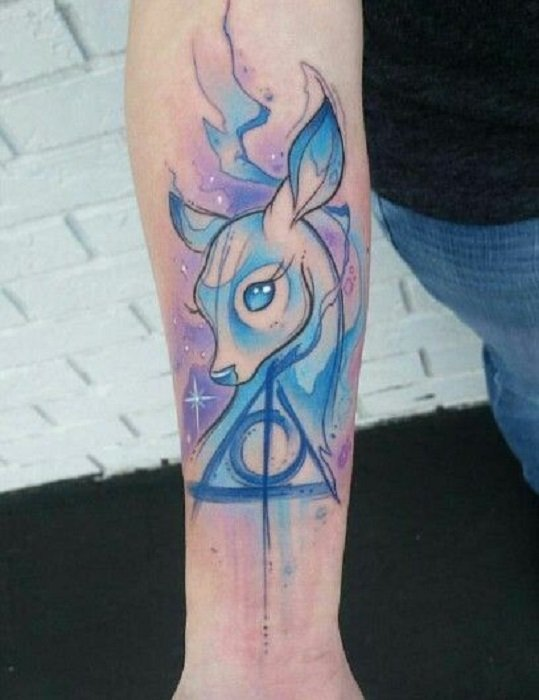 Tattoo inspired by Harry Potter, from the patronus of Professor Snape and the symbol of the relics of death