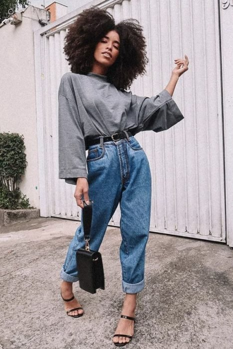 Brunette girl with baggy denim pants and gray blouse