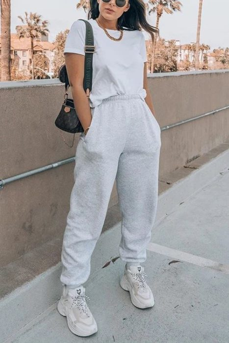 Woman with baggy sports pants and gray blouse