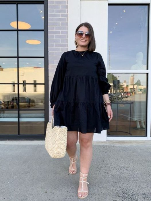 Plus size woman in black dress and square basket bag