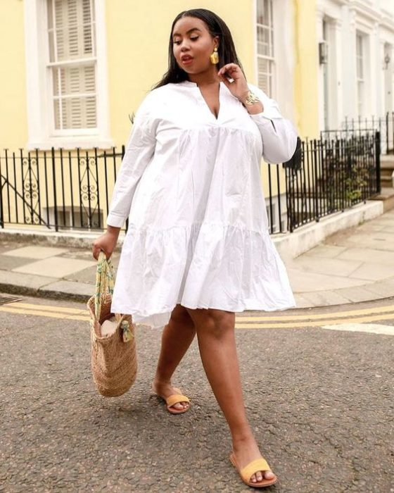 Plus size woman in white dress and basket bag