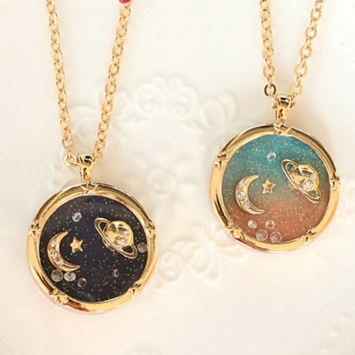 Necklace inspired by the universe with a golden chain and charm of the Moon and Saturn