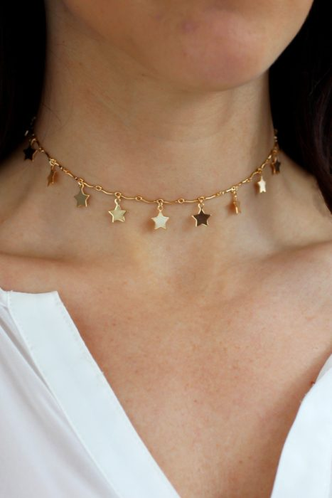 Universe-inspired necklace with small gold-colored stars fitted around the neck