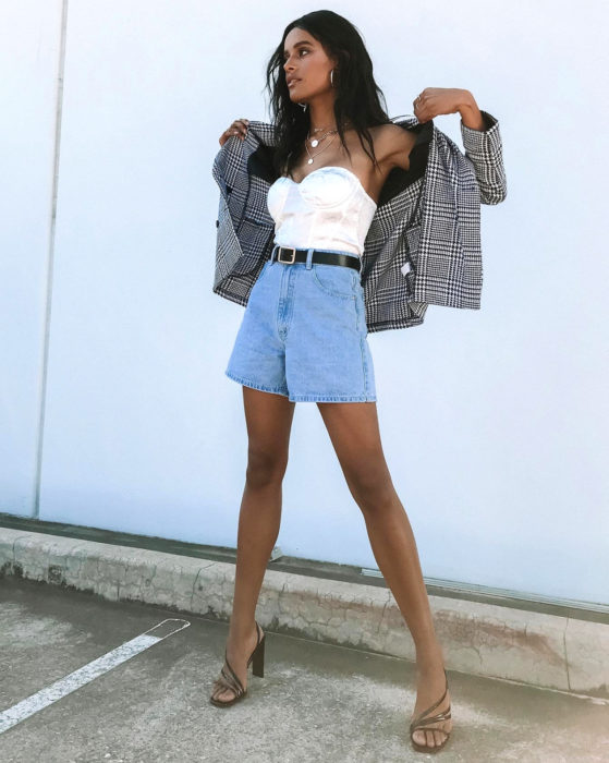 Looks with vintage shorts; brunette woman in plaid jacket, white corset and square-heeled sneakers
