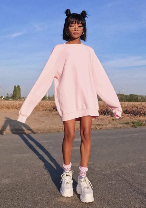 Looks with sweatshirt; brunette girl with short black hair, with Sailor Moon chong hairstyle, oversized pastel pink hoodie as dress, with white platform tennis shoes