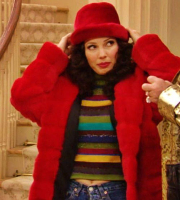 Outfits by Fran Drescher from 'La Niñera'; plush red coat and beanie for the cold, colorful striped blouse