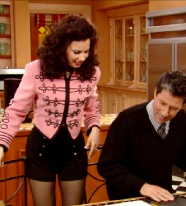 Outfits by Fran Drescher from 'La Niñera'; pink military style jacket and black shorts