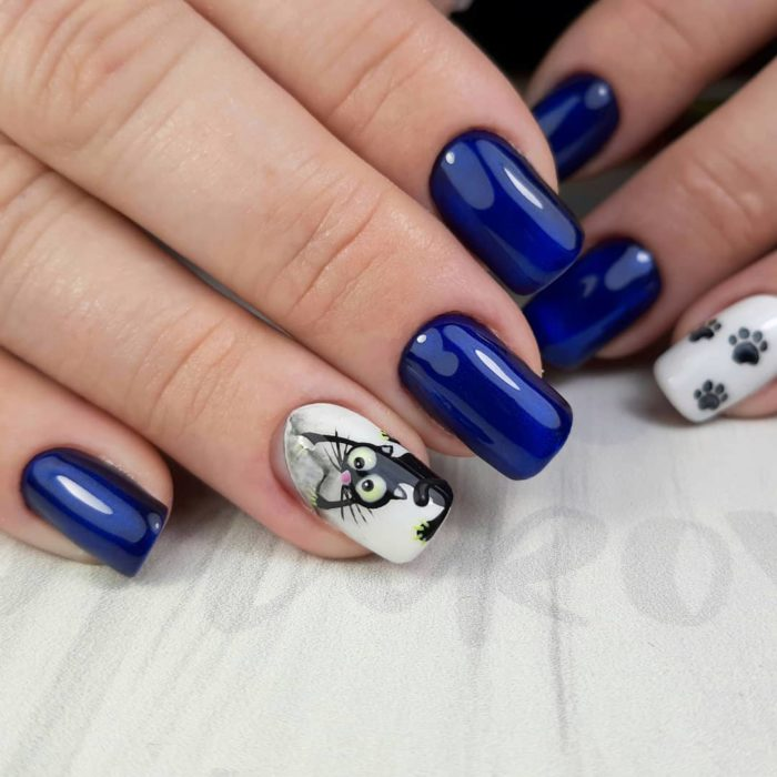 Manicure in king blue tone with cat decoration on sticker